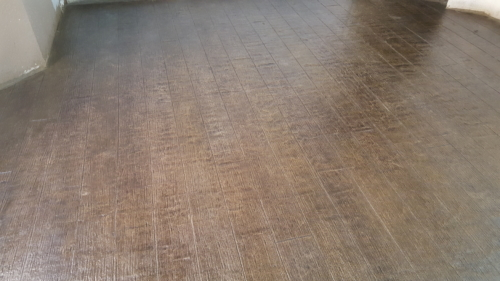 Hardwood floor replica concrete overlay